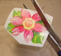 Trim Off excess newspaper and gift wrap paper, then cut out flower